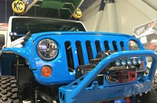 KC HiLiTES FLEX LEDs on the Front of Blue Jeep