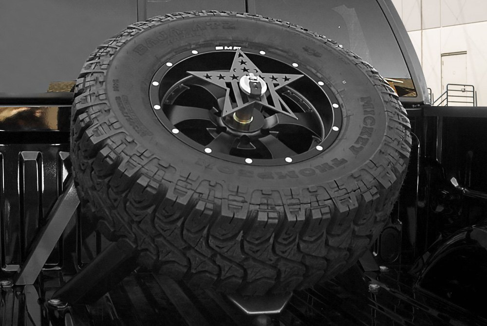 bed mounted spare tire carrier