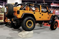 Race Ramps® - Orange Jeep Wrangler on Show Rock