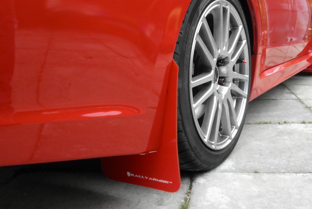 Rally Armor Red Mud Flaps With White Logo On Car