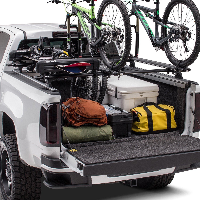 ridgelander hinged tonneau cover with bike racks and snowboard