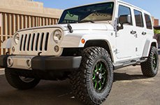 VISION OFF-ROAD® - FURY Gloss Black with Green Spokes on Jeep Wrangler