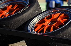 YOKOHAMA® - Advan A005 Tires on Orange Wheels